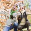 Senior couple throwing leaves in the air — Stock Photo