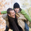 Father giving son piggyback — Stock Photo #4754997
