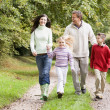 Family on walk through countryside — Stock Photo