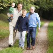 Grandfather walking with son and grandson — Stockfoto #4755098