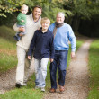 Stock Photo: Grandfather walking with son and grandson