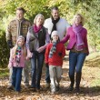 Multi-generation family on walk through woods — Stock fotografie