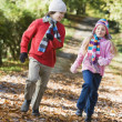 Stock Photo: Two children playing in woodland