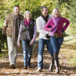 Family group walking through woods — Stock Photo #4755127