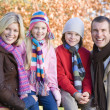 Family on autumn walk — Stock Photo