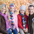 Family on autumn walk — Stock Photo #4755131