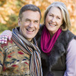 Stock Photo: Affectionate senior couple on walk