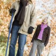 Couple raking up autumn leaves — Stock Photo