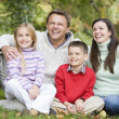 Family relaxing in woods — Stock Photo