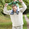 Father giving young son ride on shoulders — Stock Photo