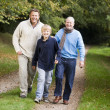 Grandfather walking with son and grandson — Stock Photo