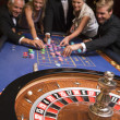 Group of friends gambling in casino — Stock Photo #4755188