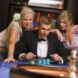 Royalty-Free Stock Photo: Man with glamorous women in casino
