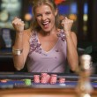 Royalty-Free Stock Photo: Woman winning  at roulette table