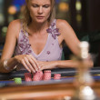 Woman concentrating at roulette table — Stock Photo