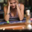 Woman losing at roulette table — Stock Photo