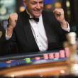 Stock Photo: Man celebrating win at roulette table