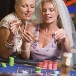 Woman celebrating bridal shower in casino — Stock Photo