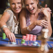 Royalty-Free Stock Photo: Two women gambling at roulette table