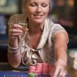 Royalty-Free Stock Photo: Woman gambling at roulette table