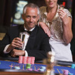 Couple gambling at roulette table — Stock Photo #4755261