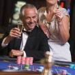 Couple gambling at roulette table — Stock Photo #4755262
