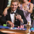 Couple gambling at roulette table — Stock Photo