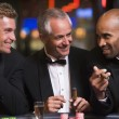 Royalty-Free Stock Photo: Three men gambling at roulette table
