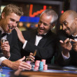 Three men gambling at roulette table — Stock Photo #4755283