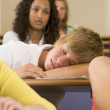 Male college student sleeping through a university lecture — Stock Photo #4755356