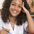 Stockfoto: Female college student listening to university lecture