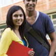 Stock Photo: Male and female college students on campus