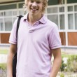 Male college student on campus — Stock Photo