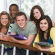 Group of college students leaning on banister — Lizenzfreies Foto