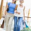 Two friends shopping in mall — Stockfoto