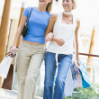 Two friends shopping in mall - Stock Photo
