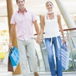 Stock Photo: Couple shopping in mall