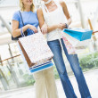 Stock Photo: Friends shopping in mall
