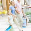 Family shopping in mall — Stock Photo