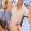 Stock Photo: Couple shopping in store