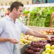 Stock Photo: Mshopping in produce section