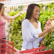 Woman shopping in produce section — Stock Photo #4757690