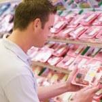 Man buying fresh meat — Stock Photo