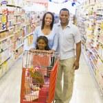 Family shopping in supermarket — Stock Photo
