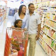Family shopping in supermarket — Stock Photo #4757703