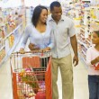 Family shopping in supermarket — Stock Photo #4757704