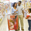 Family having disagreement in supermarket — Stock Photo