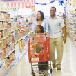 Family shopping in supermarket — Stock Photo #4757706
