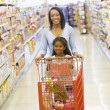 Mother and daughter shopping in supermarket — Stock Photo #4757708