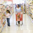 Mother and daughter shopping in supermarket — Stock Photo #4757710